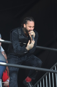 Known for his crazy antics, Jason Aalon Butler takes to the upper cat walk during their set.